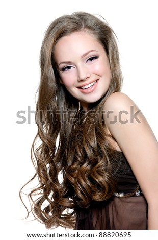 Young happy beautiful teen girl with  long curly hairs - isolated on white - stock photo