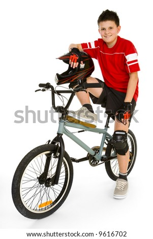 Young, happy biker sitting on BMX and looking at camera. Isolated on white background. - stock photo