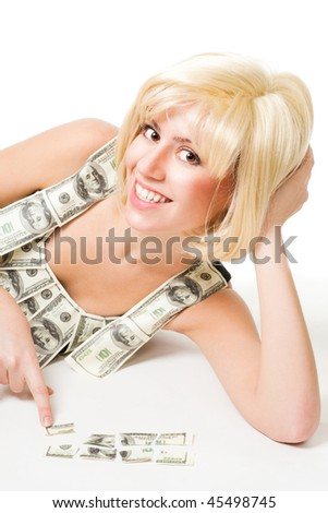 Young happy blond woman fit mosaic puzzle of dollar, laying on the floor
