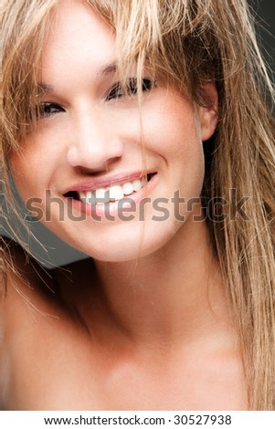 young happy blond woman portrait - stock photo