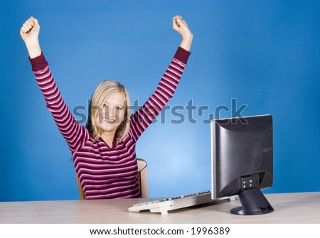 young happy blonde woman at the computer (blue background) - stock photo