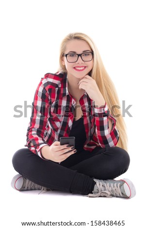 young happy blondie woman sitting with mobile phone in her hand isolated on white background - stock photo