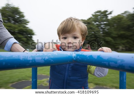 Young Happy boy having fun at playground.  - stock photo