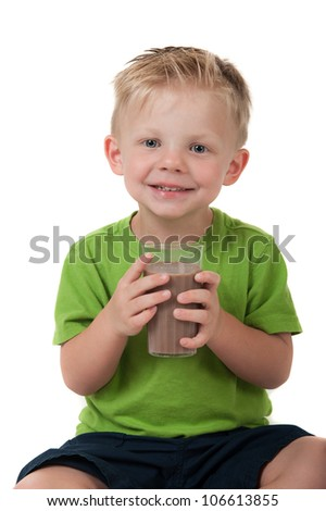 Young happy boy holding chocolate milk in a green shirt on a white background - stock photo