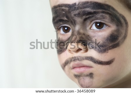 "young happy boy in ""The Zorro"" make-up"
