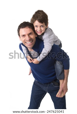 young happy Brazilian father carrying on his back little son smiling and having fun together isolated on white background - stock photo