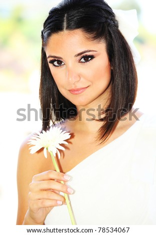 Young happy bride portrait with flower, wedding day