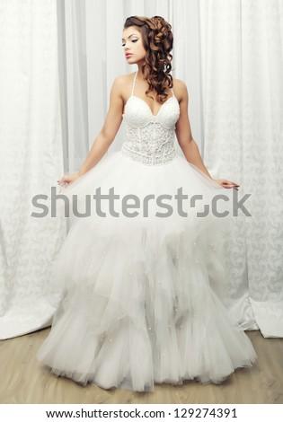 young happy bride posing in hotel room - stock photo