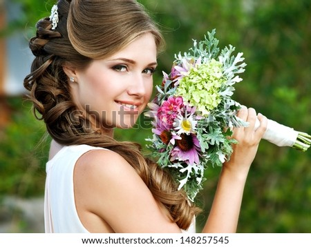 Young Happy Bride With Flower Bouquet  - stock photo