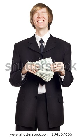 Young happy business man holding cash - stock photo