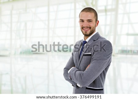 young happy business man portrait at the office