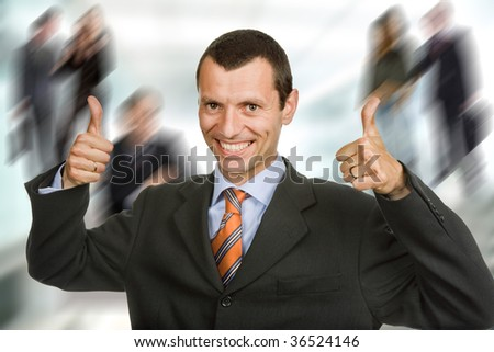 Young happy business man showing thumbs up - stock photo