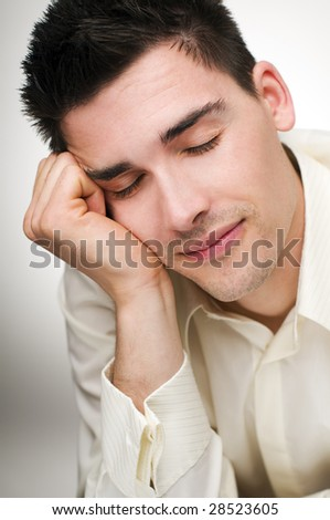 young happy business man sleeping close up - stock photo