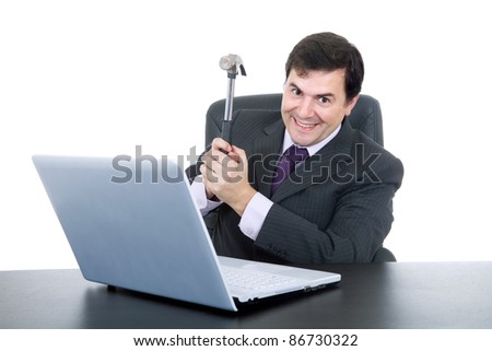 young happy business man with a hammer smashing a laptop - stock photo