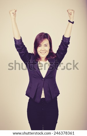 Young happy business woman win concept, process color - stock photo