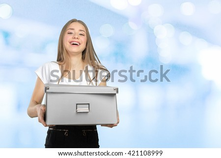 Young happy business woman with a box to move to a new office - stock photo