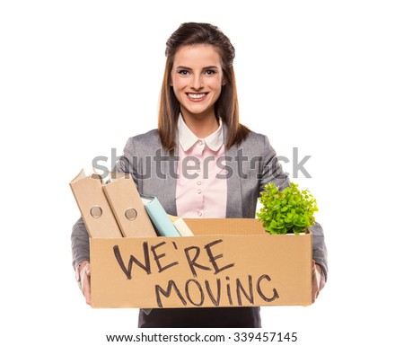 Young happy business woman with a box to move to a new office. Studio shot, isolated on a white background