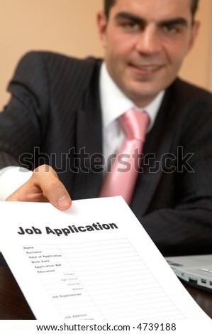 young happy businessman giving a job application form