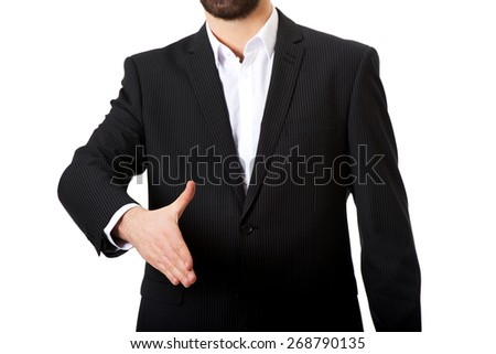 Young happy businessman offering a handshake. - stock photo