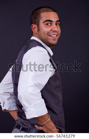 young happy businessman, on a black background