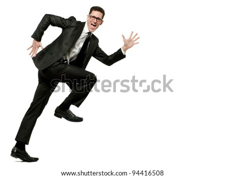 Young happy businessman runs in black suit on white. - stock photo
