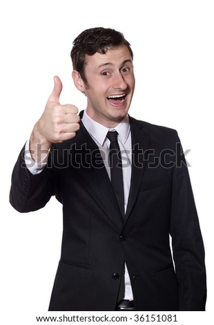 young happy businessman showing thumb up