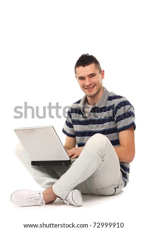 Young happy businessman with laptop, isolated on white - stock photo