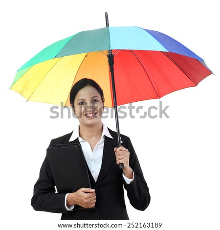 Young happy businesswoman holding a umbrella - stock photo