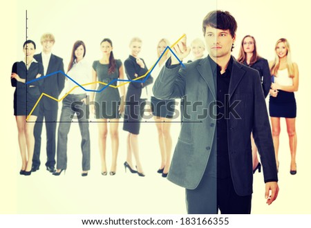 Young happy businesswoman pointing growth on graph - stock photo