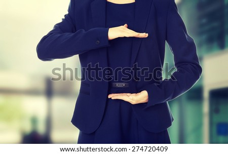 Young happy businesswoman showing copyspace - stock photo