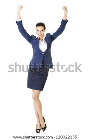 Young happy businesswoman with hands up, isolated on white - stock photo