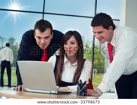 Young happy businesswomen chat on lap-top with colleagues