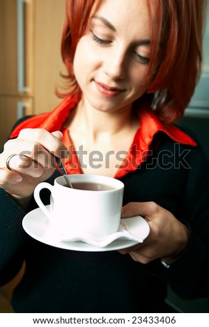 young happy caucasian businesswoman with cup of coffee