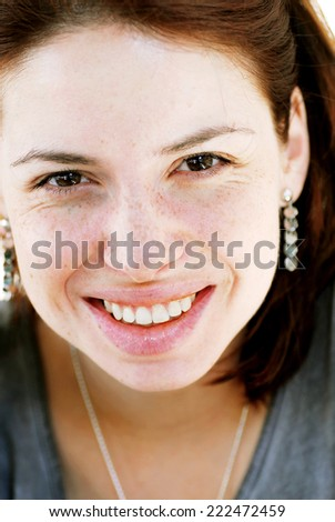 young happy caucasian smiling woman portrait with freckles on face - stock photo