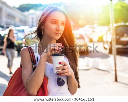 Young happy caucasian woman enjoy coffee in morning city park outdoor. Relax lifestyle summer concept - stock photo