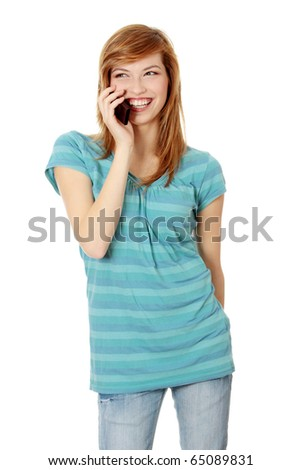Young happy caucasian woman is calling with a mobile phone isolated on white - stock photo