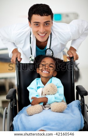 Young happy child being cared for by a doctor - stock photo
