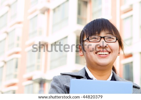 young happy chinese business woman