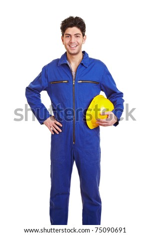 Young happy construction worker in a blue jumpsuit - stock photo