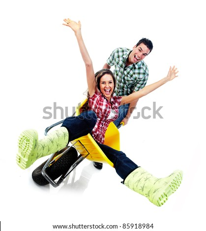 young happy couple and gardening. Isolated over white background. - stock photo