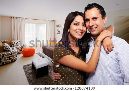 Young happy couple at bedroom