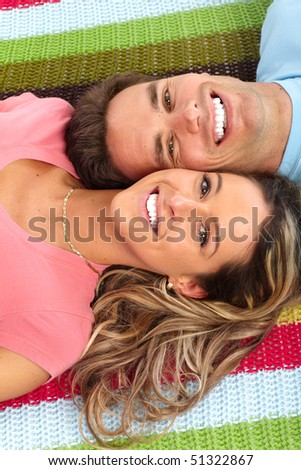 Young happy couple at home - stock photo