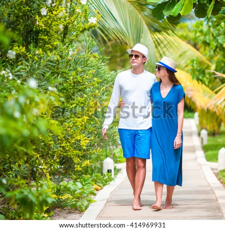 Young happy couple at summer vacation - stock photo