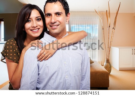 Young happy couple at their new house - stock photo