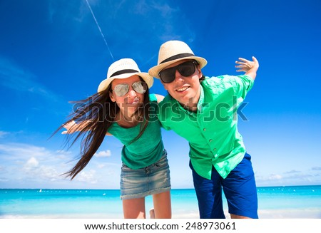 Young happy couple during tropical beach vacation