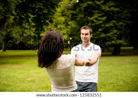 Young happy couple enjoying life together - outdoor youth lifestyle - stock photo