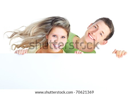 Young happy couple holding a white placard - stock photo