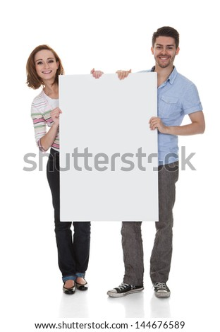 Young Happy Couple Holding Placard Over White Background - stock photo
