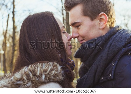 Young happy couple hugging in the park