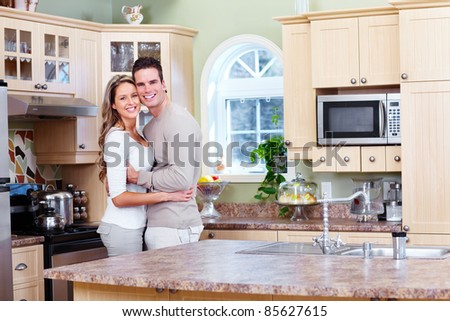 Young happy couple in a new house. - stock photo